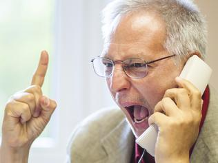 Angry senior businessman yelling at the phone