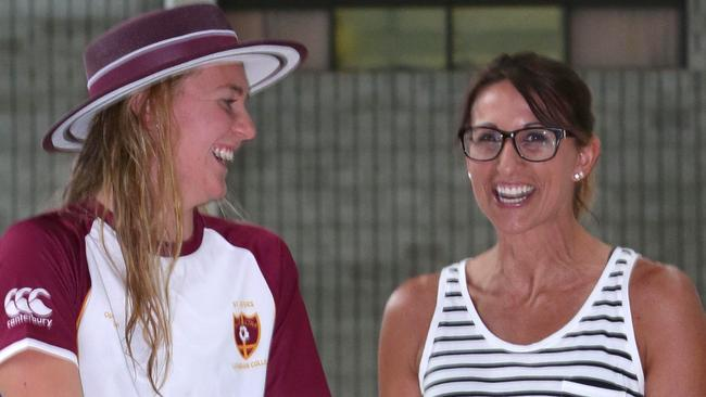 Hayley Lewis with current schoolgirl star Ariarne Titmus who will be in action on the Gold Coast.