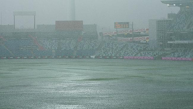 Rain lashes down in Geelong before the NAB Challenge match on Wednesday.
