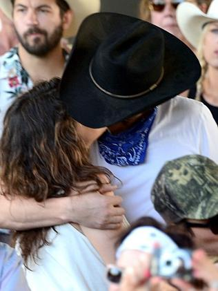 Mila Kunis and Ashton Kutcher share a passionate kiss. Picture: Getty