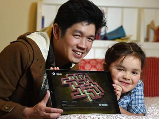 Jon Soong and his daughter Leela, six, with computer