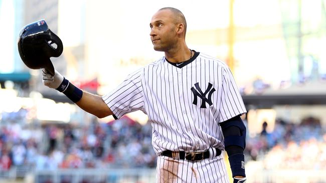 Derek Jeter #2 of the New York Yankees salutes the crowd.