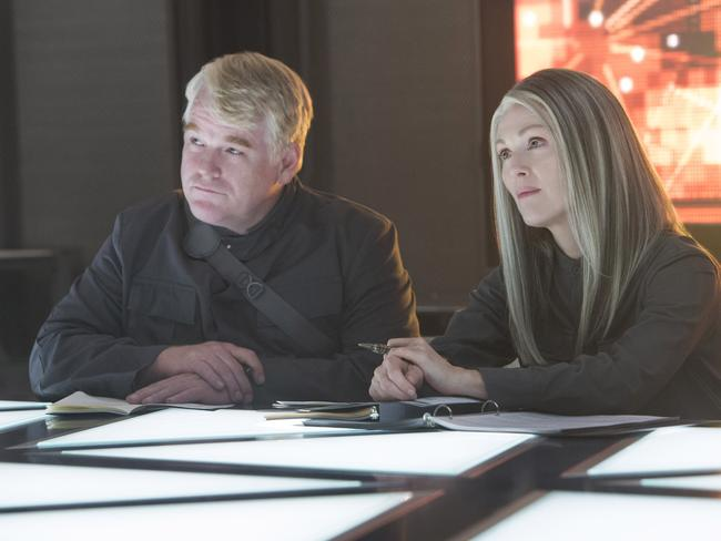 Philip Seymour Hoffman as Plutarch Heavensbee and Julianne Moore as President Coin.