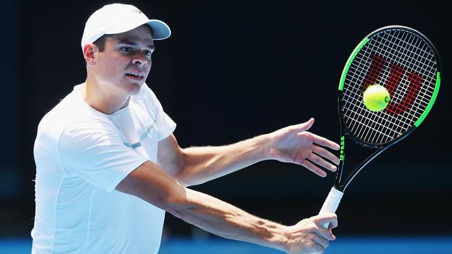 Milos Raonic hits up on Rod Laver Arena. Picture: Getty