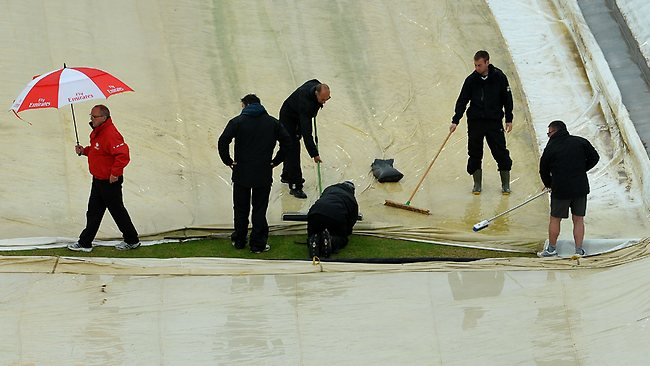 Groundstaff mop up rain during during what turned out to be an abandoned Champions Trophy match between Australia and New Zealand at Edgbaston.