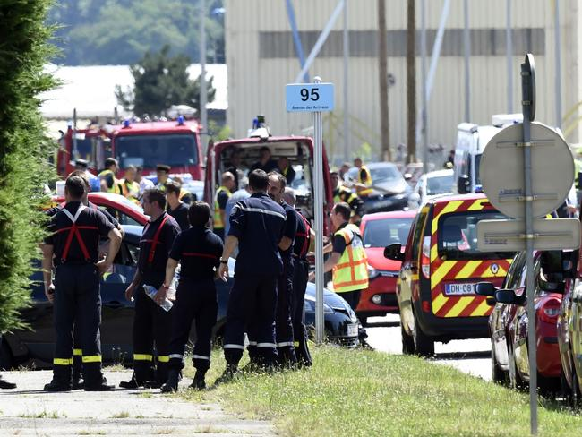 Terrorist alert across country ... French police and firefighters at the entrance of the Air Products company in Saint-Quentin-Fallavier, France, where an attacker carrying an Islamist flag killed one person and injured several others. Picture: AFP / Philippe Desmaze