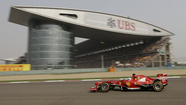 Fernando Alonso steers his Ferrari on the way to victory in Shanghai.