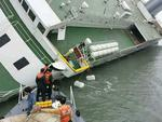 In this handout image provided by the Republic of Korea Coast Guard, passengers are rescued by the Republic of Korea Coast Guard from a ferry sinking off the coast of Jindo Island on April 16, 2014. Picture: Getty
