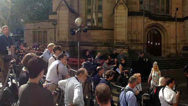 Crowds arrive early to catch a glimpse of the Royal couple who will attend an Easter Sunday church service at St Andrew's cathedral in Sydney. Picture Toby Zerna