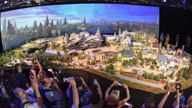 Members of the media get their first look at a detailed model of Star Wars land.