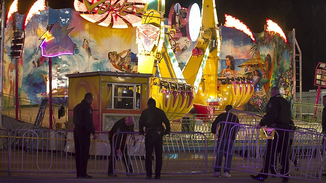 Fairgrounds Police secure a barricade around the Vortex after an accident closed the ride on Thursday at he North Carolona State Fair in Raleigh.