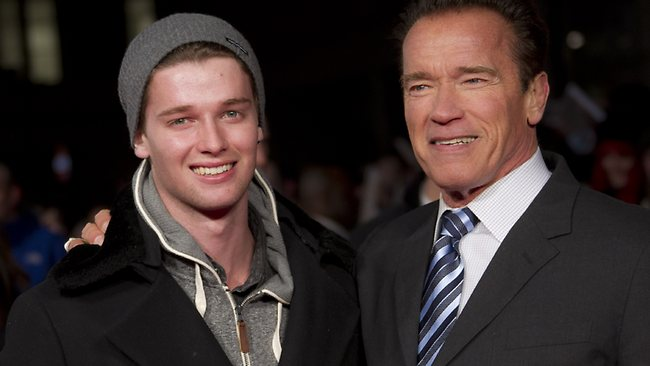 Arnold Schwarzenegger's son Patrick, left, was thrown out of a nightclub for throwing ice cubes at the DJ and threatening to beat him up. Picture: AP