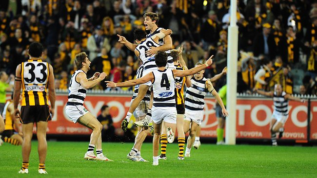 Tom Hawkins celebrates with his teammates after kicking the winning goal after the siren to continue Hawthorn's run of outs against the Cats. Picture: George Salpigtidis