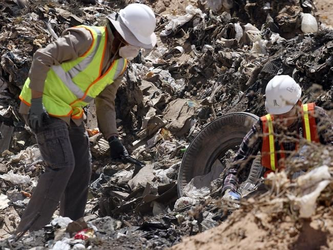 Trash or treasure? ... Workers sift through the landfill in Alamogordo, New Mexico. Pictu