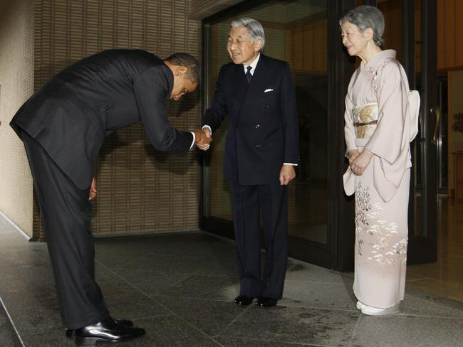 Then US President Barack Obama bows as he is greeted by Japanese Emperor Akihito and Empress Michiko at the Imperial Palace in Tokyo, 2009. Picture: AP Photo/Charles Dharapak.