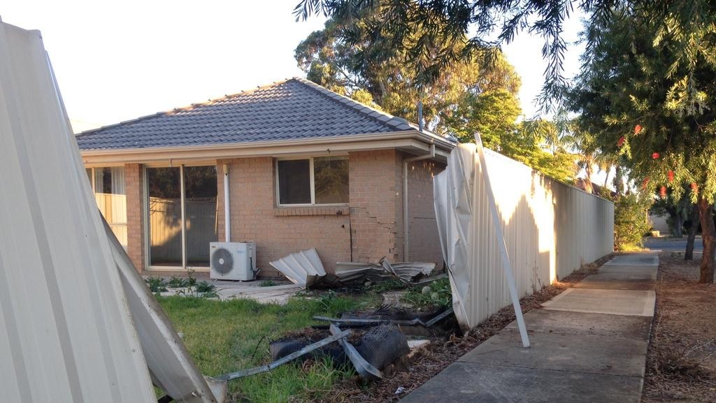 A car has crashed through a fence and into an Ascot Park house. Picture: Mitch Mott