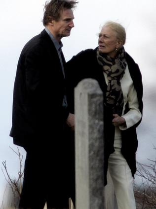 Liam Neeson and his mother-in-law Vanessa Redgrave walk through St. Peter's Cemetery in Lithgow, New York after a funeral for his wife, Natasha Richardson.