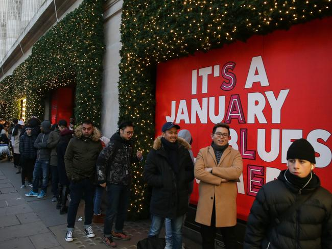 Customers queue to enter Selfridges department store during the Boxing Day sale in central London. Picture: AFP