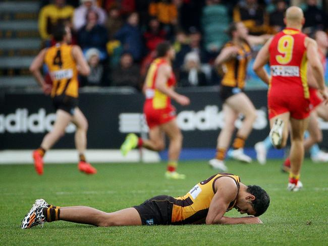Cyril Rioli on the deck after injuring his hamstring. Picture: Colleen Petch
