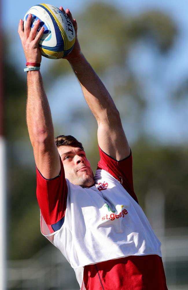 Tim Buchanan jumps for a ball at Reds training.
