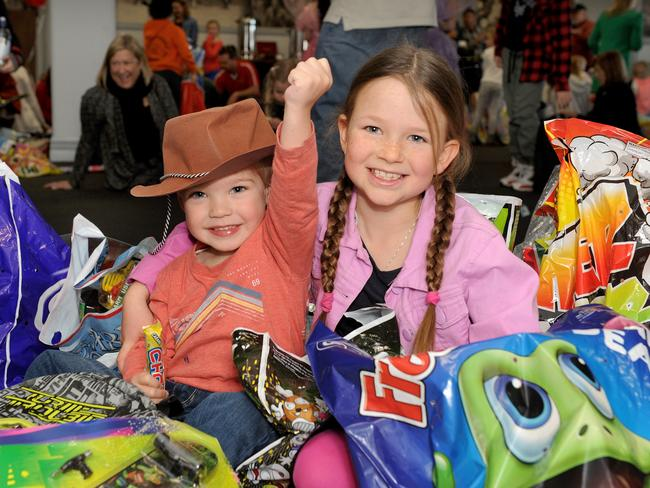 Charlie Smith, 3 and Belle Fotheringham, 8, check out the showbags.