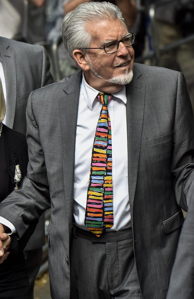 A small smile ... Rolf Harris arrives at Southwark Crown Court in London. Picture: Niklas Halle'n