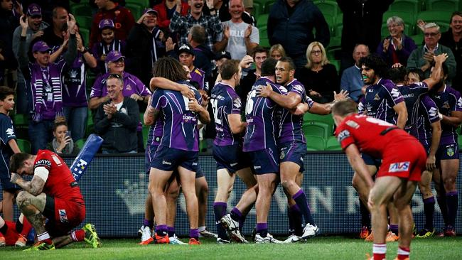 Melbourne Storm celebrate their winning try against the Dragons . Picture: Colleen Petch.