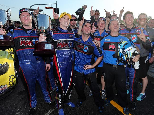 Mark Winterbottom celebrates winning race 19 in Darwin with his Ford crew last month.