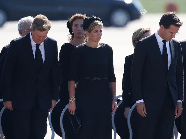 King Willem-Alexander (L) of the Netherlands stands with Queen Maxima (centre) of the Netherlands and Dutch Prime Minister Mark Rutte (R). Picture: Peter Macdiarmid