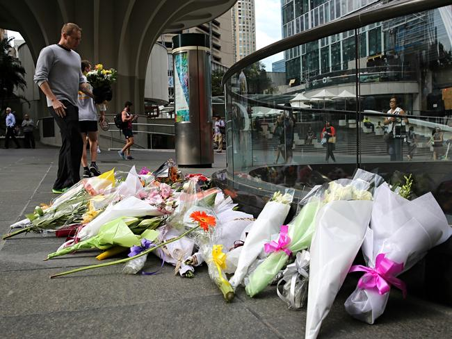 Many people leaving flowers at Martin Place after the siege ended. Picture: John Grainger