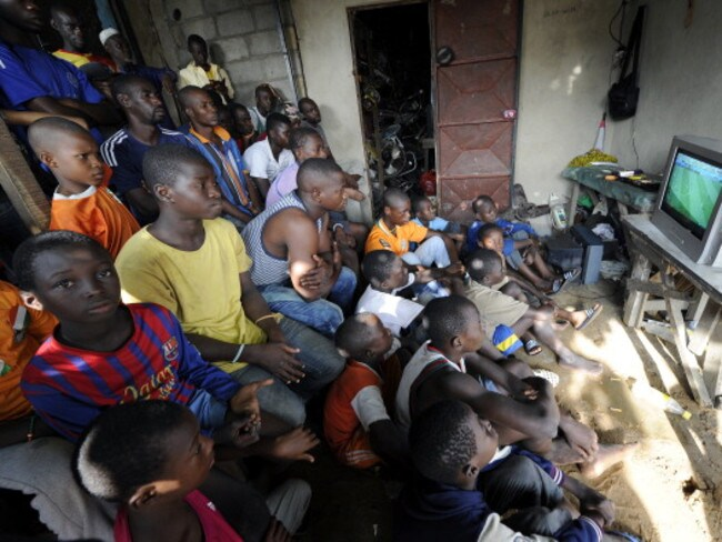Ivory Coast fans watch the FIFA World Cup 2014 football match against Colombia in Brazil.
