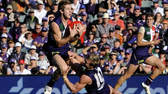 Fremantle's Michael Barlow suffers a horror injury against Port Adelaide in 2011. Picture: Lincoln Baker
