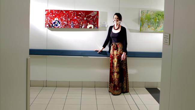 Joannah Underhill with a gallery of her paintings, many of which depict cells, at the Royal Brisbane and Women's Hospital in 2012. Picture: Mark Cranitch