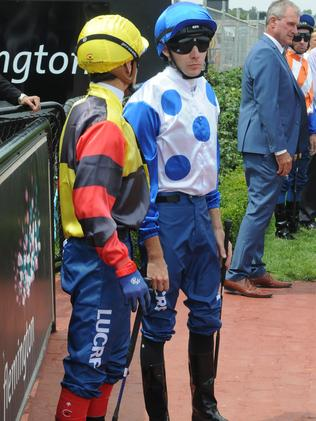 Jockeys Craig Williams, left, and Declan Bates donned the blue breeches to raise awareness for Dolly's Dream Foundation at Flemington on Saturday.