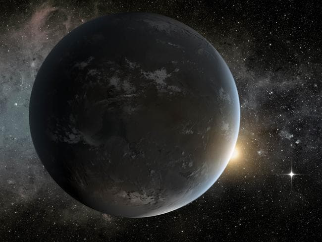 Eye on space ... An artist's concept depicts NASA's Kepler mission's smallest habitable zone planet. Seen in the foreground is Kepler-62f, a super-Earth-size planet in the habitable zone of a star smaller and cooler than the sun, located about 1200 light-years from Earth in the constellation Lyra.
