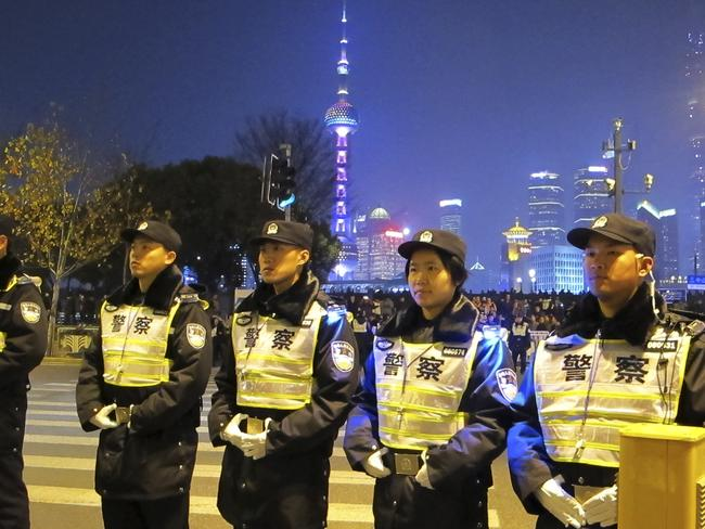 Chinese police officers stand on duty.