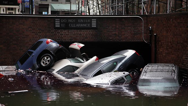Cars are submerged at the entrance to a parking garage in New York's Financial District in the aftermath of superstorm Sandy. Picture: Richard Drew