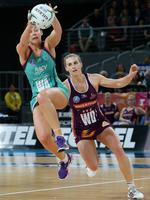 Vixens WA Madi Robinson gets possession in front of Firebirds WD Gabi Simpson. Picture: Norm Oorloff