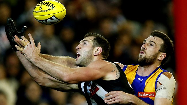 Travis Cloke strethces for a mark against, Eric Mackenzie. Picture: Wayne Ludbey