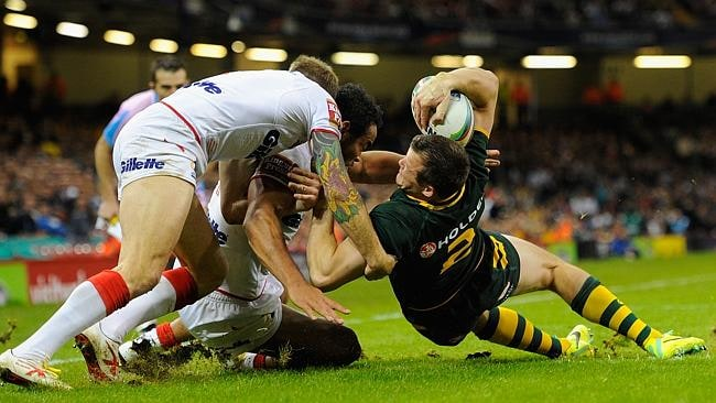Brett Morris beats the England defence to score during the Rugby League World Cup Group A match between Australia and England at Millennium Stadium.