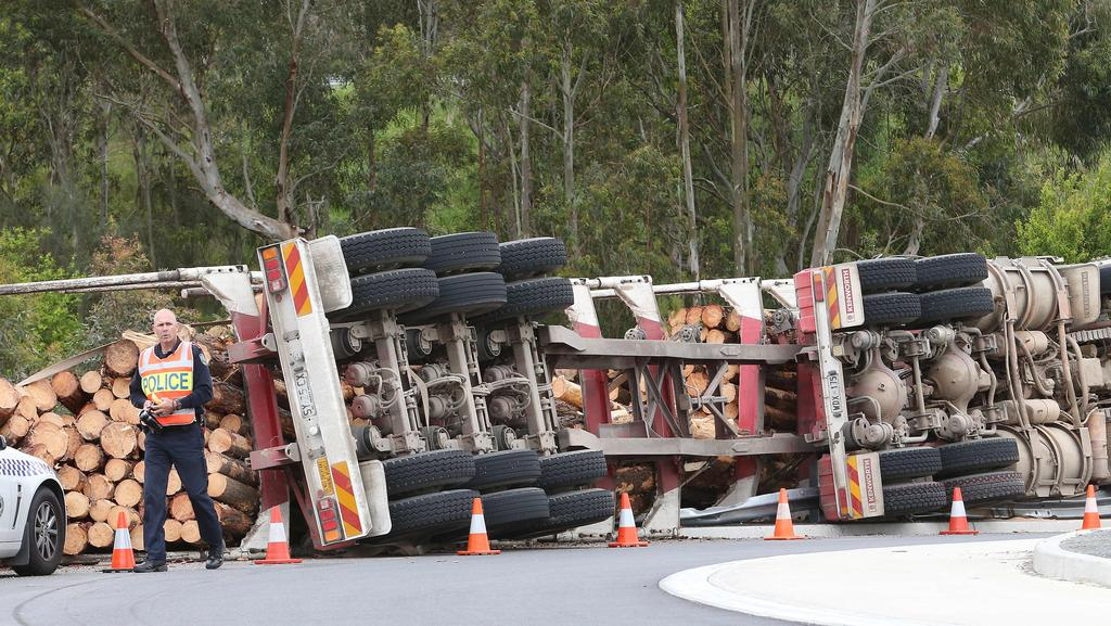 Amazingly the truckie escaped almost unscathed after his truck overturned near Mount Barker. Picture: Stephen Laffer