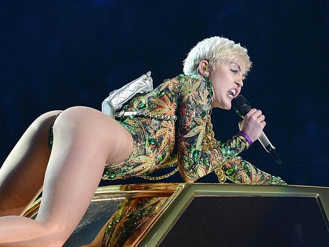 'Murder Montana' ... Miley Cyrus sexes up her show to distance herself from her former Disney image.