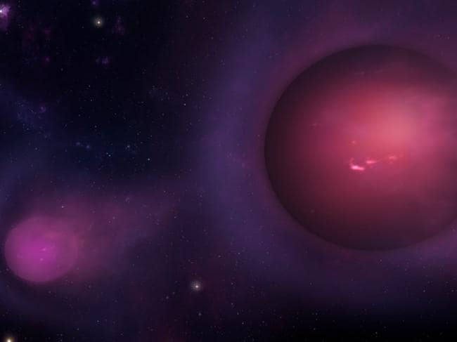 Dull 'spitballs' of gas about the size of Jupiter may be being hurled out of the Milky Way by the black hole at its centre. Picture: CFA