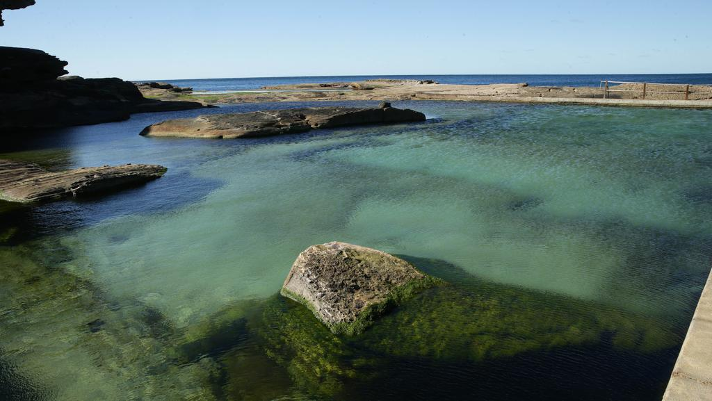 rock moved by june storms in north curl curl pool