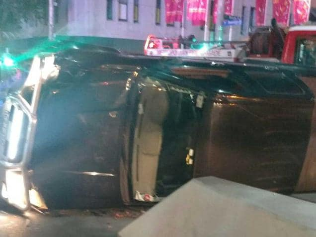 Hunt for driver as car flips in CBD
