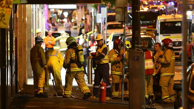 Police and emergency services in Dixon Street last night. Picture: Bill Hearne