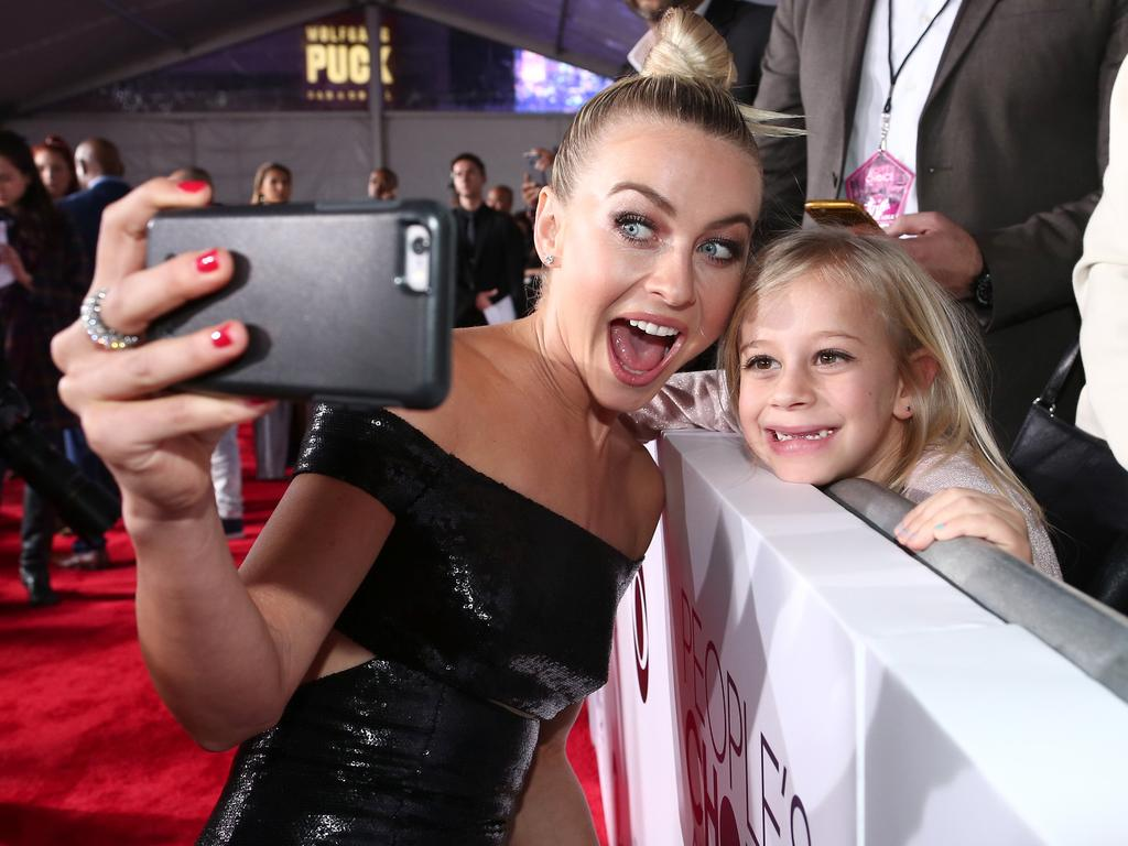 Julianne Hough takes a selfie with a fan at the People's Choice Awards 2016. Picture: Christopher Polk/Getty