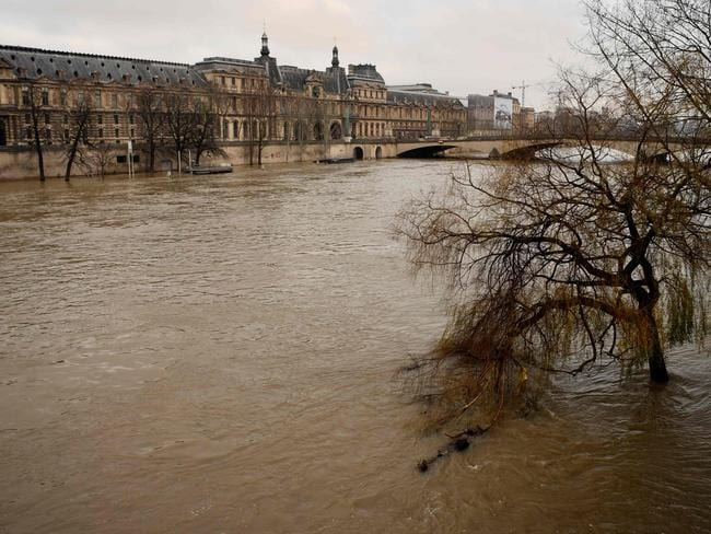 The Seine burst its banks near the Louvre Museum, parts of which have been closed. Picture: AFP
