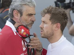 Ferrari chief Maurizio Arrivabene, left, talks with Ferrari driver Sebastian Vettel of Germany during a temporary halt at the Formula One Azerbaijan Grand Prix in Baku, Azerbaijan, Sunday, June 25, 2017. (Valdrin Xhemaj/Pool via AP)