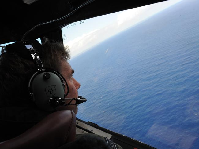 There has been no trace of MH370 since it went missing in March. Pictured ANZAF pilot Brett McKenzie searches off the coast of Perth. Pic: AFP.